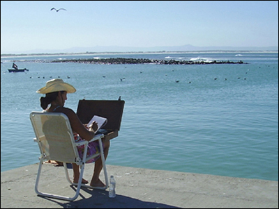 Linda painting at Struisbaai harbour